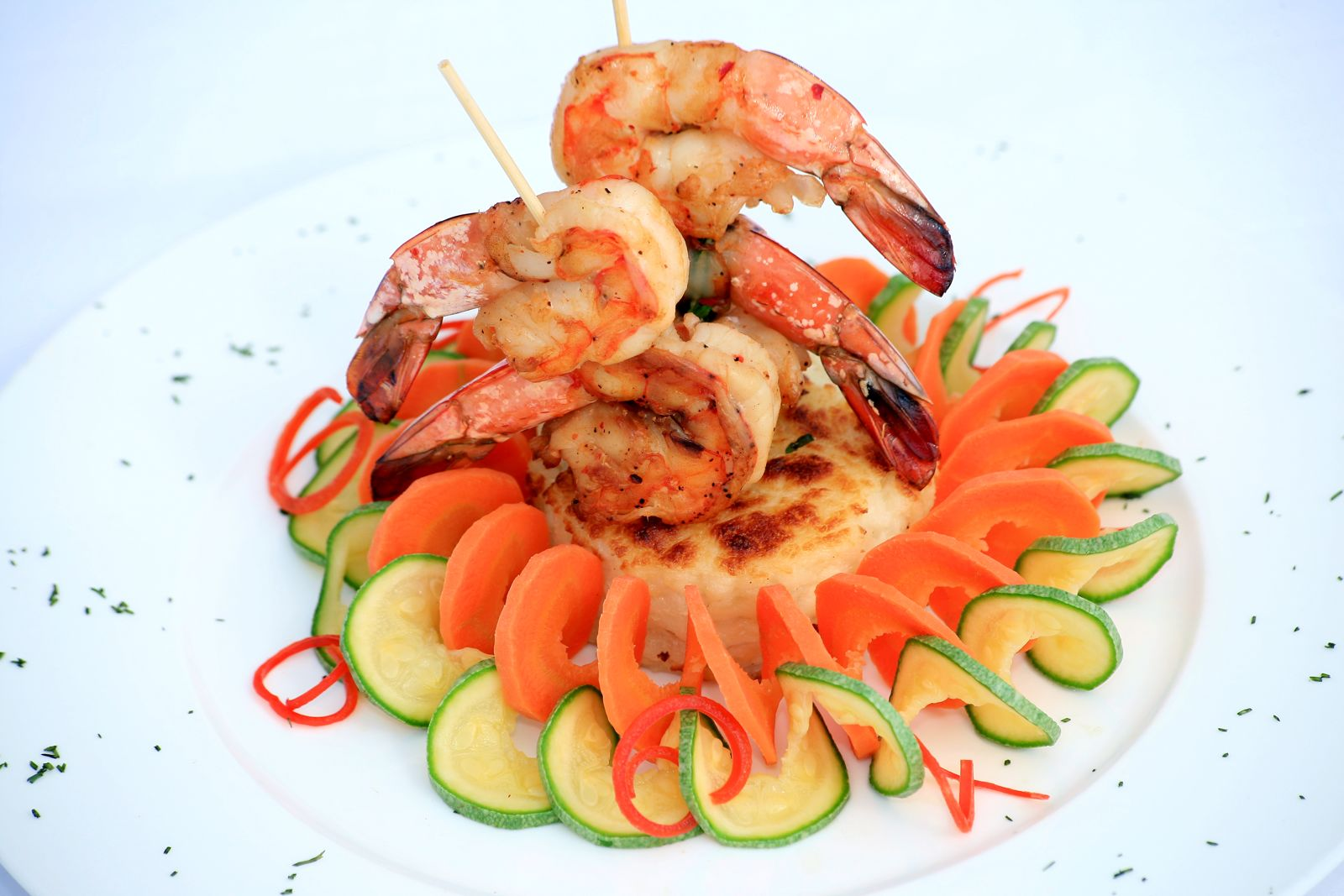 Grilled Prawns kebab with scallops potato and vegetables serpentin