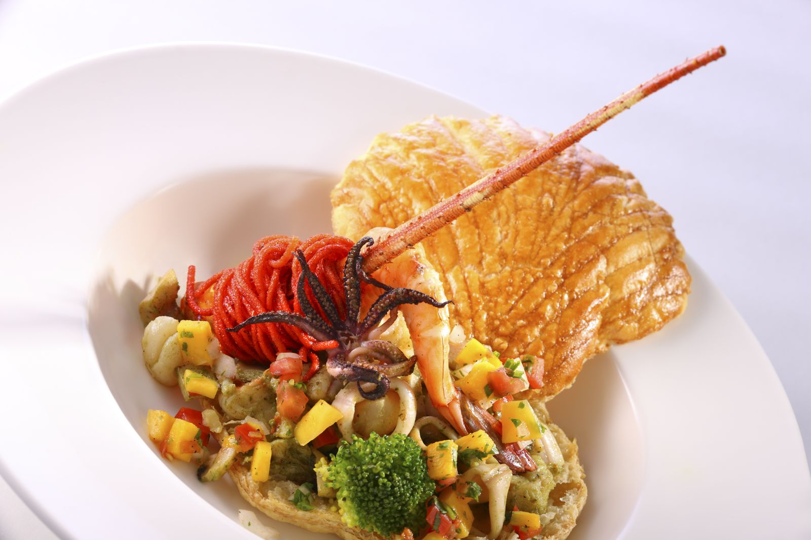 Seafood thousand leaves with a safran creamy sauce